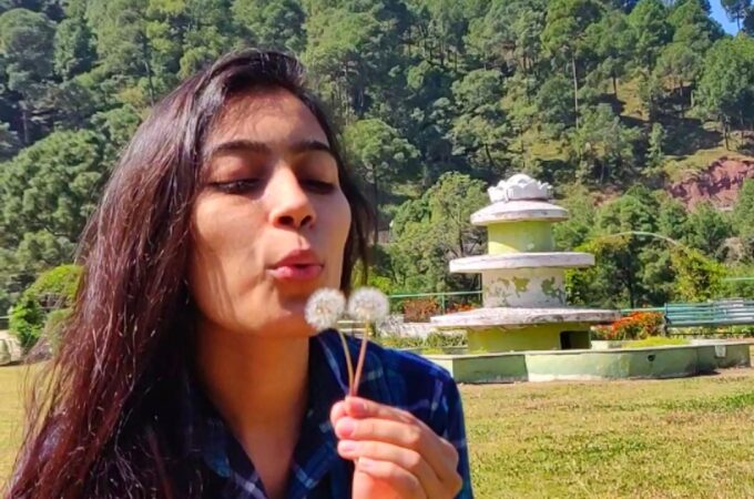 Shivani Rana blowing dandelion - Humans of Himachal